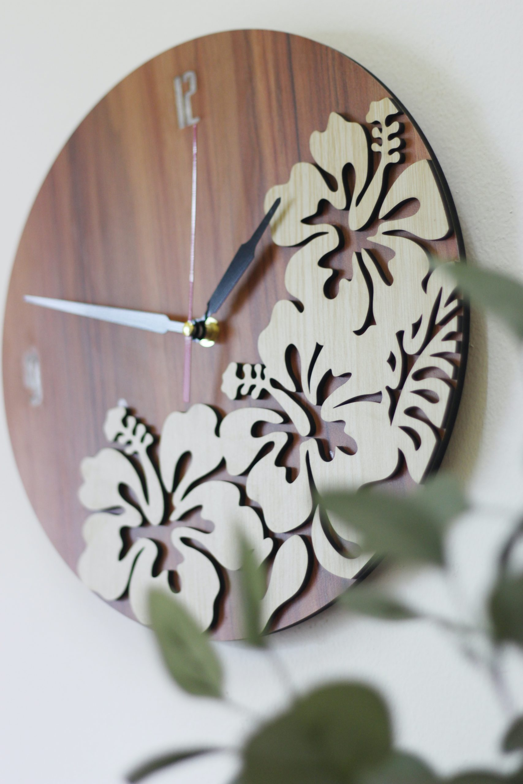 brown and white floral round analog wall clock